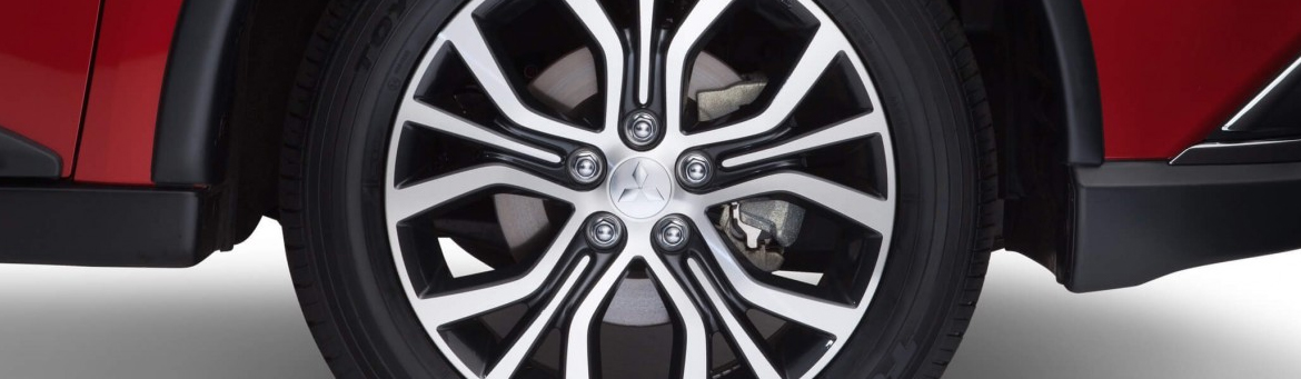 Close up of an alloy wheel on a Mitsubishi ASX in red.