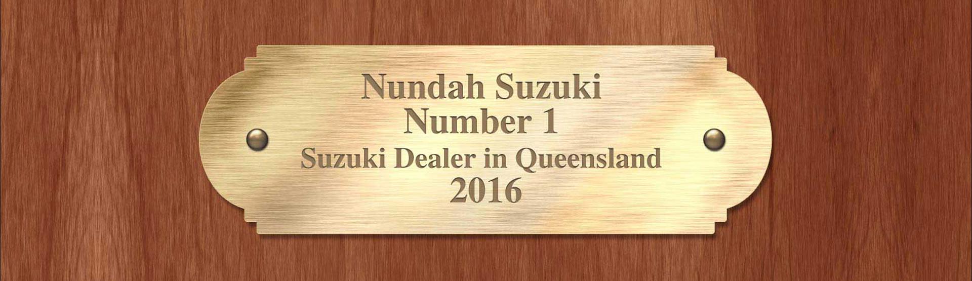 Nundah Suzuki Brisbane, the Number 1 Suzuki Dealer in Queensland 2016 written on a gold plaque.
