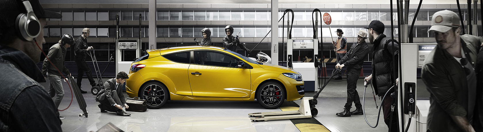 Renault Megane R.S in liquid yellow in a simulated racing pit stop.