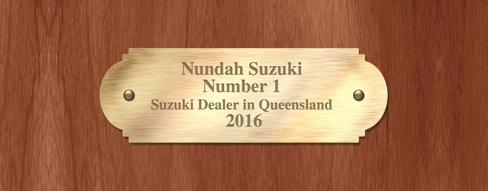 Nundah Suzuki Brisbane, the Number 1 Suzuki Dealer in Queensland 2016 written on a gold plaque.