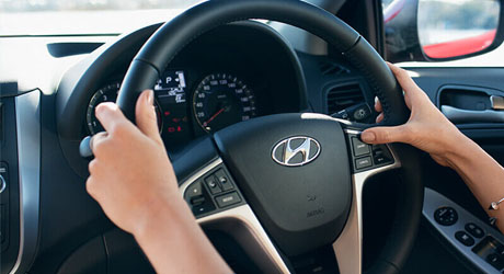 Accent  Premium steering wheel with mounted controls.