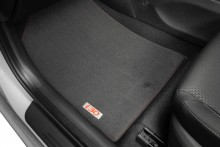 Tailored carpet floor mats (set of 4) - red stitching and red badge.