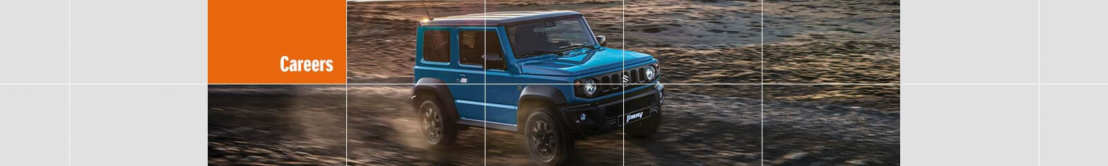 Suzuki Jimny driving on sand