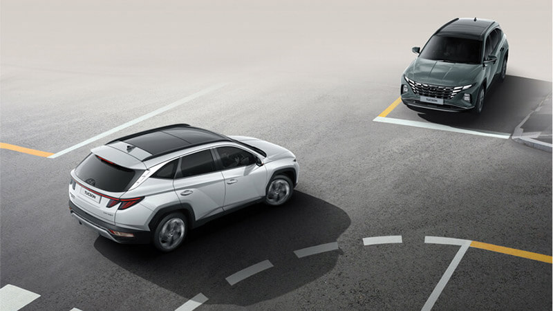 Tucson Forward Collision-Avoidance Assist (FCA) with Junction Turning (JT).