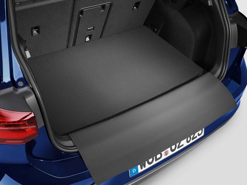 Luggage compartment reversible mat with protective flap