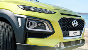 Kona Top-bottom split design front headlamps.