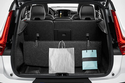 Foldable load floor with cargo divider and grocery bag holder Image