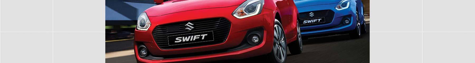 Suzuki Swift GL hatch in snow white pearl.