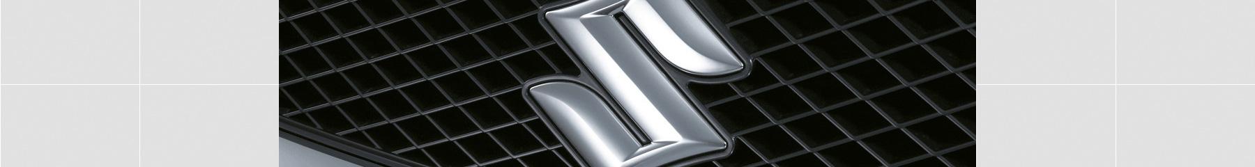 Close up of the Suzuki emblem on the grille of a Suzuki Swift hatch in silver.
