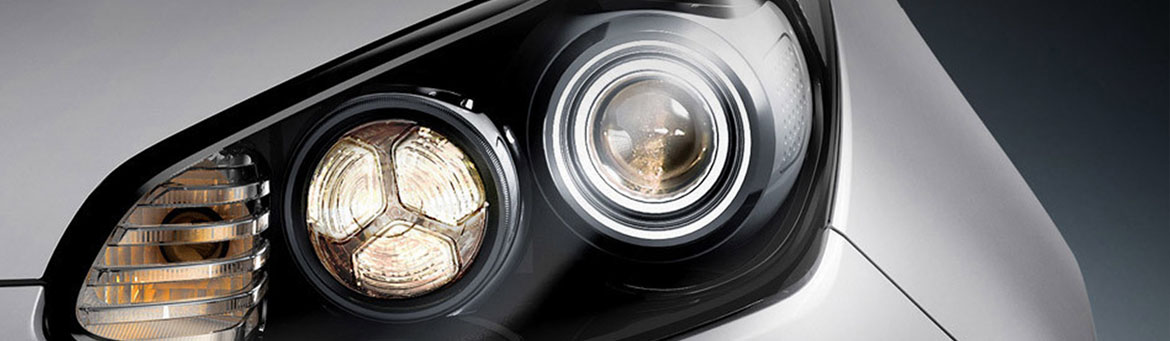 Close up of the front headlights of a Kia.