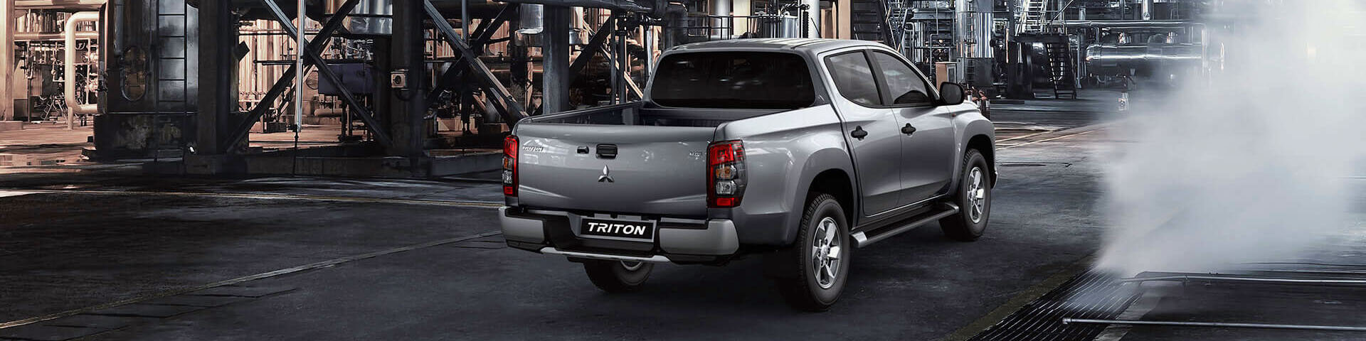 Rear view of a Mitsubishi Triton dual cab ute in silver.