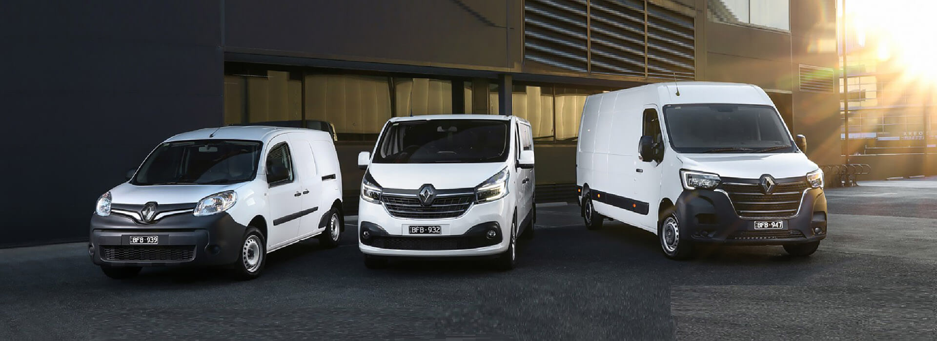 Renault Trafic vans in bamboo green and mercury grey hard at work on the building site.