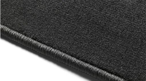 Textile passenger compartment mats