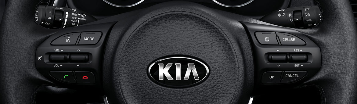 Close up of the Kia multi-function steering wheel controls.