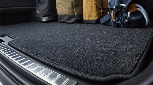 Reversible textile/plastic load compartment mat