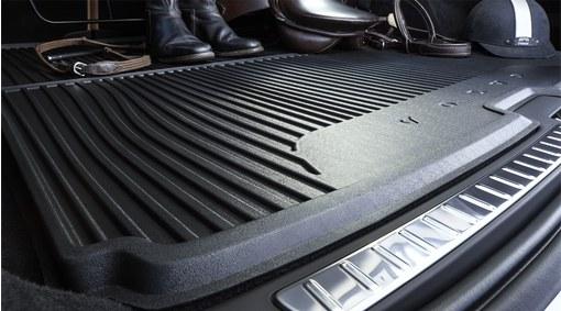 Shaped plastic load compartment mat