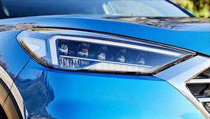 Tucson Restyled headlamps and daytime running lamps.