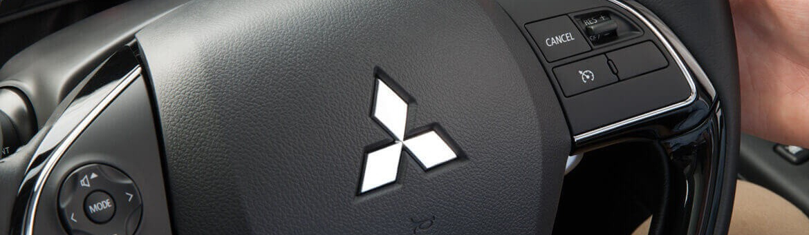 Close up of multi-function controls on a Mitsubishi steering wheel.