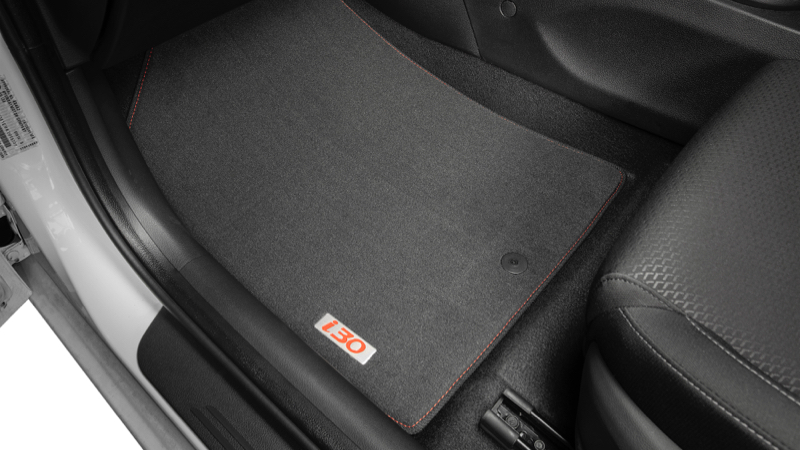 """<img src=""""Tailored carpet floor mats - red stitching and red badge."""